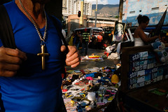 Medellin, Colombia (f.d. walker) Tags: cross religion religious christian christianity catholic catholicism streetphotography street sunlight shadow surreal candidphotography candid color colorphotography clothes city jesus market medellin colombia southamerica latinamerica juxtaposition