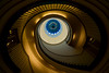 Blue eye (Maerten Prins) Tags: berlijn duitsland deutschland germany berlin berggruen museum stair stairs stairwell staircase spiral curve curves upshot blue window round circle dark brown gold yellow black shadow railing skylight architecture