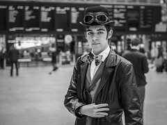The Traveller (Leanne Boulton) Tags: portrait urban street spontaneous portraiture streetphotography streetportrait eyecontact streetlife man male face expression eyes look emotion mood atmosphere feeling steampunk character cosplay costume vintage victorian travel railway train station tone texture detail depthoffield bokeh indoor light shade city scene human life living humanity society culture lifestyle style fashion people canon canon5d 5dmkiii ef2470mmf28liiusm black white blackwhite bw mono blackandwhite monochrome glasgow scotland uk bowtie bowlerhat