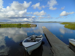 Harray loch (stuartcroy) Tags: orkney island reflection clouds beautiful blue bay boat