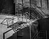 Fire Escape Shadows (tim.perdue) Tags: columbus ohio downtown urban city building architecture olympus omd em10mkii tamron 14150mm fire escape shadow light alley detail contras brick wall windows boarded up decay abandoned empty neglected forgotten