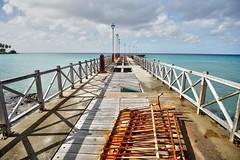 Abandoned Jetty Speightstown (hitennaik) Tags: barbados caribbean speightstown west indies jetty abandoned pier boardwalk rusty sea ocean water palm trees wood