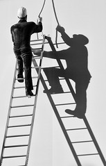 Man on the Ladder (laga2001) Tags: shadow shadowplay theater ladder man sunlight low sun working worker grey black white bnw monochrome street streetphotograhy blackandwhite perspective