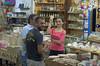 Friendly Greek girl in a local shop (Dmitriy'Os'Ivanov) Tags: girl greek rhodes women posing friendly positive victoria v sign people greece pentaxk5 pentaxda55mmf14 joy smile travel journey kolimbia