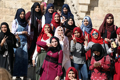 All we are saying is 'Give peace the chance'… (ybiberman) Tags: israel jerusalem oldcity alquds muslimquarter damascusgate girls adolescent hijab smartphone selfie fuss pose vposture happy smile palestinian portrait candid streetphotography sunglasses