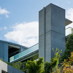 Concrete elevator, and glass handrail are symbol of Ando's work.