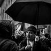 Man with Umbrella - Jan 2018 (stevedexteruk) Tags: umbrella kurd kurdish man langham place street city westminster london uk 2018 chatting talking rain blackwhite bw mono 1x1 square portrait