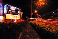 Fosters (OzGFK) Tags: 35mm asia fuji hollandvillage nikkor nikon singapore velvia analog crossprocessed film night xpro lighttrails longexposure fosters hollandroad