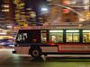 City Bus (deepaqua) Tags: night street bus mta motion streetlamp skyline columbuscircle nyc