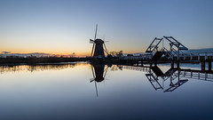 Calm sunset at Kinderdijk (Rob Schop) Tags: wideangle alblasserdam zonsondergang calm sonya6000 molens nederland outdoor cold hoyaprofilters winter pola bridge samyang12mmf20 reflection windmill a6000 sunset f8 kinderdijk