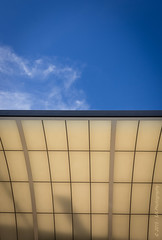 Blue Over  Cream (SJS Photog) Tags: 40mm abstract blue camera canon colors hollywood lightroom socal southerncalifornia busstop clouds cream curves fullframe lines overhang sky streetphotography tan 6d