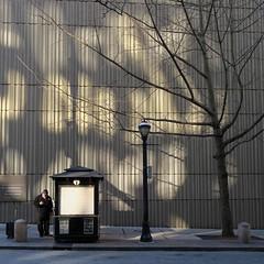 writing on the wall (jim_ATL) Tags: man smartphone street sunlight winter reflection concrete facade building atlanta