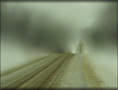 The Long Road Home (LupaImages) Tags: car road dirt snow winter slippery wet snowy transportation drive outdoors outside travel tracks vehicle lights