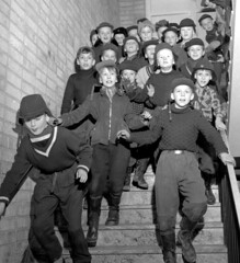 Lunch time (theirhistory) Tags: children kids boys hat jacket stairwell trousers wellies cap boots class form school pupils students education
