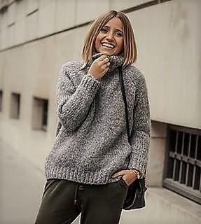 Women in knitted turtleneck