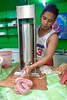Making sausages,Central Market, Iloilo, Philippines (Yekkes) Tags: travel philippines visayas iloilo iloilocentralmarket work sausages machinery process labour makingsausages meat