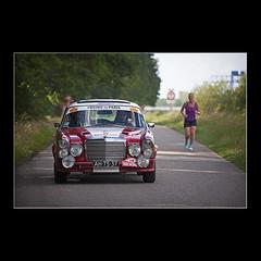 The Unfair Race (KoenK68) Tags: race car runner woman road pekingtoparis competition sports vehicle running driving canon ©koenk68