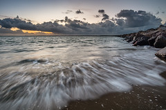 Sunset at Brouwersdam, with my jackboots on! (Rob Schop) Tags: wideangle zonsondergang sunset sonya6000 water noordzee outdoor weather motionblur sea motion sun ouddorp beach nederland landscape strand pola wolken samyang12mmf20 hoyaprofilters waves a6000 clouds f8 brouwersdam