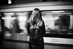 In Transit 171.365 (ewitsoe) Tags: monochrome woman stadingalone tram train transit pedestrian bnw blackandwhite ewitsoe warsaw warszawa poland city urban feel atmosphere polska polish europe central canon eos 6dii 50mm street