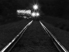 In Harm's Way (coollessons2004) Tags: train tracks blackandwhite night
