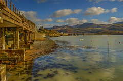 Barmouth, where the mountains and the Mawddach estuary meet the sea... (alex.vangroningen) Tags: nikond7000 northwales sea clouds sky bridge water mountains river estuary reflections wales pillars