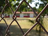 School and fence. (France-♥) Tags: 395 fence clôture lacruz mexique bokeh metal