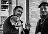 Le chien et ses amis / The dog and his friends (vedebe) Tags: noiretblanc netb nb bw monochrome humain homme human people rue street ville city urbain urban animaux chiens portraits