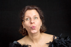 Exercise of facial muscle 6 (Traveller_40) Tags: 2xstriplight abendkleid elinchrom federn grimasse grimassenstattbotox headshot homestudio peterhurleystyle portrait striplight studio studioblitz blackbackground facialmuscle feather fun lachen laugh