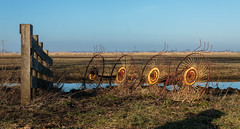 Old farmer tools (Marco van Beek) Tags: old farmer tools holland europe landscape fence shadow blue sky agricultural