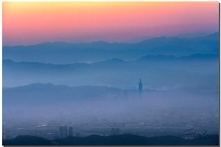 Taipei 101 and its city in Low fog, Taipei, Taiwan