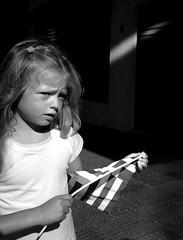 untitled (ChrisRSouthland) Tags: athens street streetphotography monochrome bw blackwhite blackandwhite streetportrait child kid flag leicammonochrom mm elmarit28mmf28