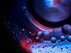 planet swirl (Ichi De) Tags: planets swirl abstract oil water light glass closeup macro pentacon vintagelens manualfocus blue red dark