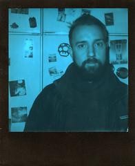 Soul Kitchen (Magnus Bergström) Tags: polaroid 680 slr polaroid680slr analog instant film 600 foldable originals polaroidoriginals duochrome black blue blackandblue portrait sweden sverige värmland wermland karlstad haga man beard fridge stickers magnets photos matung00 nintendo super mario mushroom pixelart fusebeads supermario