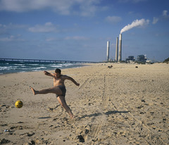Fever Pitch (Sona Maletz) Tags: photography tranquil football ball boy sand beach documentary document sea moment situation factory israel