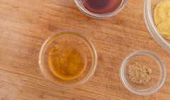 Marinade mise en place. (annick vanderschelden) Tags: food bowl glassbowl wood choppingboard ingredient marinade honey redwinevinegar ginger groundginger mustard