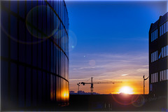 Mayflower St (mik-shep) Tags: construction building buildings crane 062 060 118picturesin2018 sunset lensflare sky offices blue warm glow sun clouds