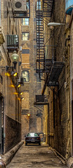 Chicago.... (Kevin Povenz Thanks for all the views and comments) Tags: 2015 june kevinpovenz chicago illinios street streetphotography narrow car ally tall yellow brick canon60d sigma