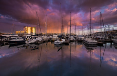 The pink hour - Plymouth Barbican (snowyturner) Tags: barbican plymouth masts boats sunset clouds showers reflections buildings light calm canon 1018mm yachts suttonharbour evening dusk pontoon marina