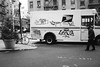 Man Walking In Front of USPS Truck (Zach K) Tags: man walking front tagged usps truck graffiti chinatown les lower east side canal street photography streetphotography parked mail mailtruck delivery deliveries deliverytruck intersection fujifilm fuji 23mm acros x100f bw black white