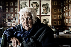 Part of the story (psarasmus) Tags: old oldwoman crete cretan greece history figures mythology myth paintings portrait coffeeplace story