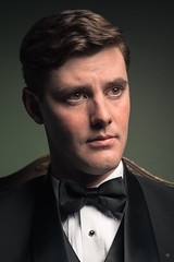 Single studio strobe with white beauty dish camera right floan high. Some bounce light from wall on left of subject and from white shirt under tux. (Fidere) Tags: portrait male simple tuxedo formal dramatic d750 nikon vintage