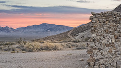 Rhyolite Sunset (magnetic_red) Tags: sunset sky clouds desert wall crumbling trail road mountains americanwest nevada