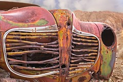 Car Grill in Desert 5615C (jim.choate59) Tags: car desert nelsonnevada jchoate rust carcass old weathered grill chrome d610 abandoned radiatorgrill decay on1pics lasvegas