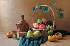 Unlimited Abundance (Esther Spektor - Thanks for 12+millions views..) Tags: stilllife naturemorte bodegon naturezamorta stilleben naturamorta composition creativephotography art tabletop abundance fruits apple pear persimmon grape basket box bottle goblet wine napkin vine leaf ambientlight glass wicker yellow orange red green burgundy brown estherspektor canon coth5