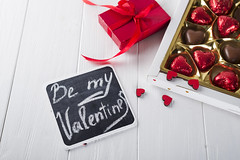Delicious chocolate candies in gift box on white wooden background (lyule4ik) Tags: heart chocolate day sweet valentine love decoration holiday romantic shape symbol background gift joy red white wood wooden candy sugar cocoa delicious dessert fat food romance tasty affection artistic bokeh bottle bride card celebration composition concept confetti creative design effect family filter glass green happy life present retro rose shaped