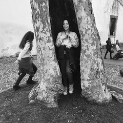 The Hidden and the Fleeing (Hive Bee) Tags: friends peschiera garda hidden fleeing children tree blackandwhite street streetview