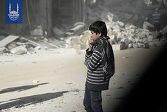 A boy overlooks the destruction in Ghouta, Syria.