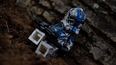 Lone wolf (RagingPhotography) Tags: lego star wars 501st clonetrooper clone trooper outside outdoor outdoors gritty serious scratched dirty filthy filth laying down lay dirt scarred scar scars weapon blaster minifigure minifig figure plastic toy toys photography republic custom customized paint job painted