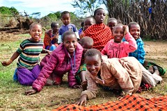 New friends, lots of photo angling and giggles. (Timothy Hastings) Tags: masai serengeti tanzania people smiles children hospitality kindness joy native africa herder shuka humanity tribe tribal colors