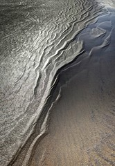 Half and half (pauldunn52) Tags: wet sand drainage water beach abstract patterns